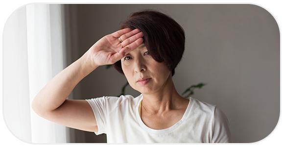 体調不良の年配の女性